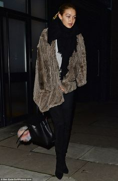 City chic: The model cut a relatively fashionable figure in a glamorous fur coat and skint...