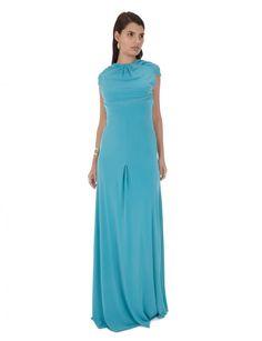 Vestido de fiesta largo color azul. Leva manga corta y escote en la espalda en forma de V.