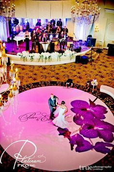 Amazing custom circle dance floor by Platinum Pro, Inc. Band is Wayne Foster Entertainment, True Photography photographs and Coordination by Creative Affairs.