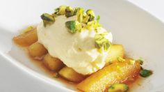 - Eplebåter i eplemost -  Apple boiled in a applemost/cider-spiced syrup and served with whipped cream and pistachios
