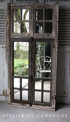 1880's Salvaged French Window - backed with mirrors - via Atelier de Campagne