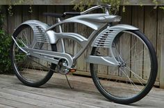 This bicycle has a very art deco feel to the design - details about this bike just can't be found anywhere. Is this a modern retro-style custom cruiser, or is it a genuine 1920-30s  (or maybe even 1950s) vintage? The mystery remains.