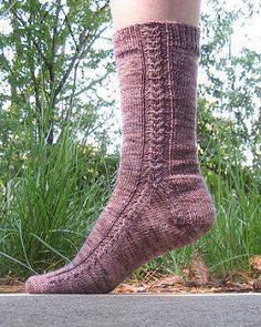 coming together is a toe up gusset heel sock pattern featuring cables that - Coloring Book Yarns