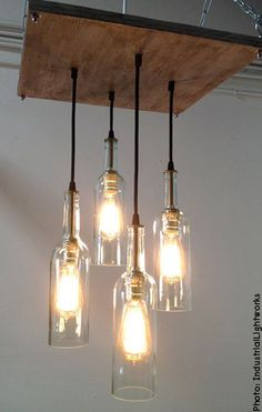 Recycle empty wine bottles and turn them into unique hanging light fixtures #recycledwinebottles
