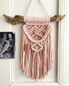 pink macrame wall hanging