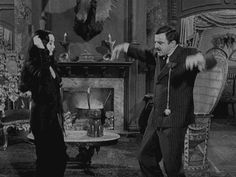 Morticia and Gomez dance.