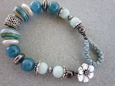 Blue Green Sterling Silver Lampwork Bracelet by MarthaDzJewelry on Etsy  I love the idea of using the peanut beads as the loop closure!