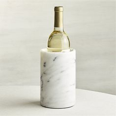Shop French Kitchen Marble Wine Cooler.  A column of cool white marble with grey veining unique to each piece chills wine at the table with classic flair.  The properties of marble naturally help wine keep its cool.