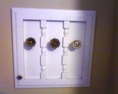Reuse for old kitchen cabinet door...glass knob coat/hat rack