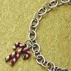 Enamel Candy Cane Charm: Featuring red enameled stripes, our festive sterling silver charm captures the joyful spirit of the holidays. #Christmas #Christmasjewelry #candycane #Jamesavery
