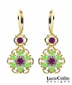 Marvelous Dangle Flower Earrings Designed by Lucia Costin Embellished with .925 Sterling Silver Flower Accents, Peridot Green and Violet Swarovski Crystals;.925 Sterling Silver Plated with 14K Yellow Gold; Handmade in USA Lucia Costin. $56.00. Garnished with peridot green and dark purple Swarovski crystals. Update your everyday style with inspiration when wearing this piece of jewelry. Unique jewelry handmade in USA. A perfect feminine touch. Lucia Costin floral Dangle earrings