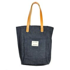 Dark Denim Vintage NYPL Stamp Tote Bag. The vintage stamp featured on this item was used in most every book acquired in the first few decades of the library's existence.