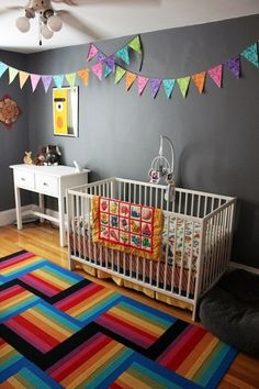 "Another view of my daughter Vivien's gray & rainbow nursery! Wall color is Benjamin Moore's ""rock gray"", rug is FLOR tiles."