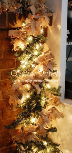 DIY: Burlap Garland Tutorial - strips of burlap tied around string lights and artificial greenery. This is an easy and inexpensive way to create a full garland - Creative Outlets of a Thrifty Minded Momma Burlap Christmas, Merry Little Christmas, Primitive Christmas, Country Christmas, Winter Christmas, All Things Christmas, Christmas Holidays, Christmas Wreaths, Christmas Ideas