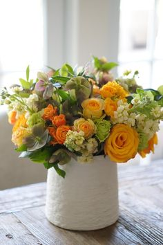 Warm yellow and green arrangement, roses, stocks, hellebores, spray roses. Made by Annalisa Style Flowers in Tenafly, NJ