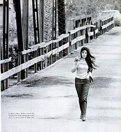 Here is Bobbie Gentry walking across the Tallahatchie Bridge in Money, Mississippi (Life Magazine, November 10, 1967). Gentry was born in Chickasaw County, MS in 1944 as Roberta Lee Streeter. Her breakout hit was Ode to Billie Joe in 1967. #folk #singer