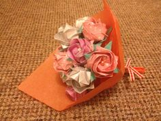 Pink. Peach & White origami roses with pearl accents.
