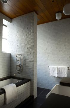 Love the texture of these walls of handmade white tiles