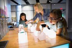 Boost a girl engineer...Girls playing with electricity grid exhibit - Hero Images/Getty Images