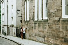 couple standing in corner of Edinburgh street