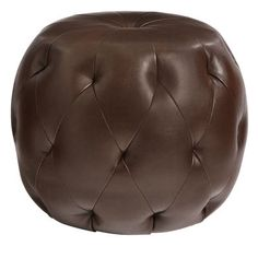 Not a small asteroid as once believed, this tufted ottoman—also called a pouf—is actually a comfy seat, hand-upholstered in soft, smooth faux leather. But asteroid would've been our second guess.