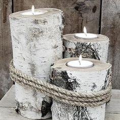 Burch Candle Holders. Reminds me of the sea too the way the three different size logs are tied together with thick rope - pilings.