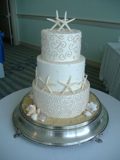 Just starfish with some pretty scroll. Kind of like this too. Can I just have multiple cakes?