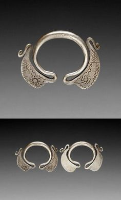 Laos | Pair of woman's earrings from the Khmou people of Muang Pek, Xieng Khouang province; silver.  | ca. early 20th century  // ©Quai Branly Museum. 71.1932.1.941.1-2