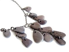Making some more of these popular river rock necklaces!  Here's the first one, in lilac :D