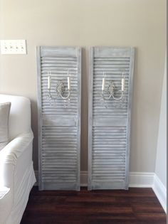 Unique ooak tall  french shabby style plug in by ShabbyHaus, $415.00 Distressed wooden shutters with vintage antique iron white crystal sconces / home décor/ wall hanging/ wall lighting plug in cord shutter sconces