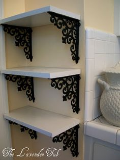 DIY floating shelves made from Hobby Lobby brackets.
