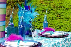 feathers, blue paper straws, bottles, birdcages