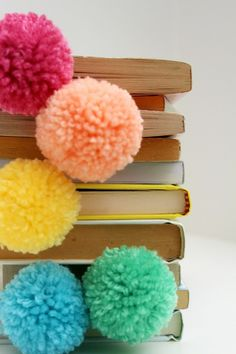 Use paperclips and pom poms to make these bookmarks.