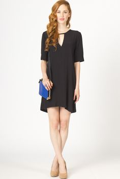 $69   this little black dress features the perfect sized key hole at the front neck, a sexy update to a pretty conservative dress.  this shift dress is sure to please.  features a zipper at the back neck