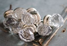 Vintage glass and chrome cupboard knobs with starburst design.
