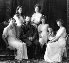 Nicholas II of Russia with the family (left to right): Olga, Maria, Nicholas II, Alexandra Fyodorovna, Anastasia, Alexei, and Tatiana…
