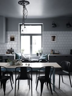 Black and white kitchen with window seat | 10 Beautiful Rooms - Mad About The House
