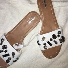 Mossimo Gem Sandals. NWT Thus pair of Mossimo Sandals are white with large gem embellishment  they are NEW with tag. (The tag is torn). They are a size 7.   They'll dress up any out fit Mossimo Supply Co. Shoes Sandals
