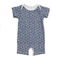 The perfect one-piece outfit. Lap neck opening and four snap buttons at the bottom for quick diaper changes. Made in Brooklyn out of organic cotton. 100% of this lovely garment including the fabric it