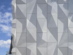 White concrete panels with a wrinkled surface by ALA Architects