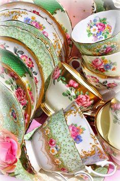 A beautiful mix of vintage teacups and saucers...tea anyone?