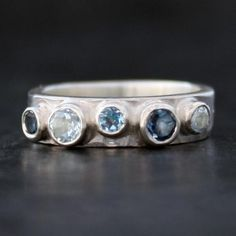 five stone hammered edge silver Iapetus blue topazs ring by Fi Mehra