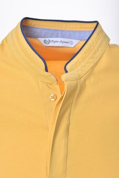 Unique and stylish T-Shirt is Cotton. The Mandarin Collar is trimmed with a contrasting stripe and this T-Shirt is offered in 4 stunning colors including Blue, Gray, Orange & Yellow. Mens Shalwar Kameez, Kurta Men, Formal Shirts For Men, Cotton Shirts For Men, Mens Polo T Shirts, Sports Shirts, Men's Shirts, Man Dress Design, New T Shirt Design