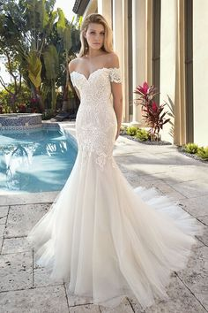 unique wedding dress Off-the-shoulder Cap sleeves add a romantic touch to this alluring Sweetheart neck Fit n flare design adorned with bold embroidered lace. A lush Tulle, flared skirt flows into a Chapel train. Arabic Wedding Dresses, Classy Wedding Dress, Fit And Flare Wedding Dress, Wedding Dress Sleeves, Wedding Dress Styles, Fit N Flare Dress, Dress Wedding, Lace Wedding, Elegant Wedding