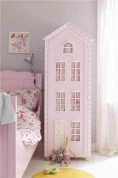 Not sure if this is just a doll house, or storage for clothes or toys.  Very cute!
