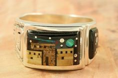 This Ring is a work of art! Beautiful Starry Night in the Pueblo Design. Featuring Picture Jasper and Black Jade inlaid in Sterling Silver Ring. Beautiful Fire and Ice Lab Opal Accents. Designed by Navajo Artist Calvin Begay. Signed by the artist.