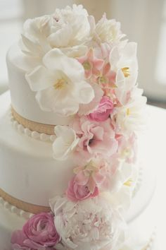White tiered wedding cake with fresh flowers, love the simplicity <3