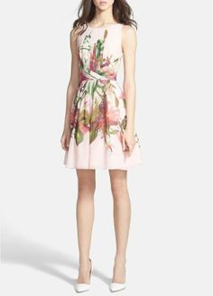 The added pleats to this orchid print fit & flare dress are breathtaking.