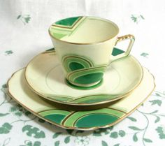 Art Deco Geometric Trio, Handpainted Grosvenor China Kelly Green, Mint and Cream Cup Saucer Teaplate 1933. via Etsy.