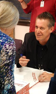 """NavPress author Arron Chambers joined two others Oct. 29, 2014 to sign books at The Navigators U.S. Headquarters. Chambers' most recent book is called """"Devoted."""""""